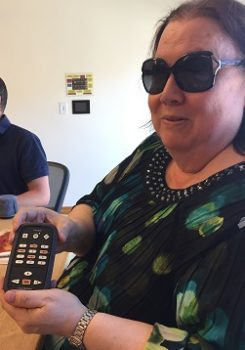 Kim Charlson holds a streaming device for use by blind readers.